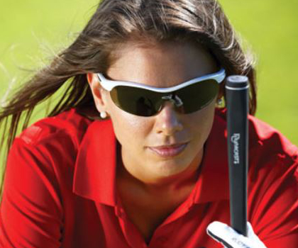 A woman using the Steady Swing golf training aid during putting.